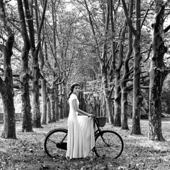 woman on bike in woods, smith contemporary black and white photography