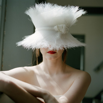 white hat color photography feathers new york photography