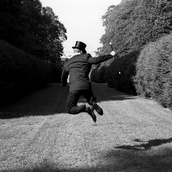 top hat, shrubs, black and white photograph, tuxedo art