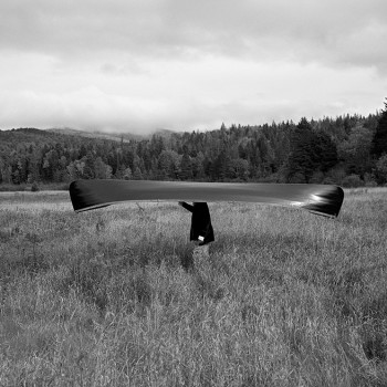 canoe as hat, humor, whimsy, black and white photography