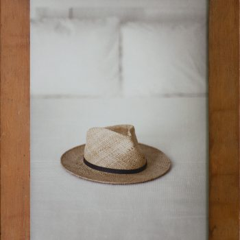 hat on bed,hayman, contemporary vintage photography